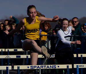 Girl running hurdles